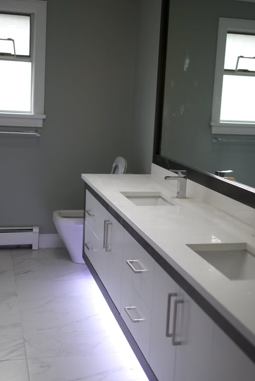 LED Underlit vanity cabinet in bathroom.